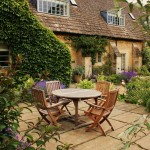 Colourful traditional 'English country garden' borders envelop the property.