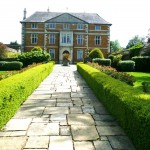 Tightly clipped box and a  generous width of path gives a perfectly proportioned walkway to this beautiful old hall.