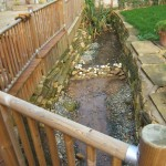 An inaccessible but lovely garden feature. Beautiful York stone slabs used as edging will be removed and used in a sunken terrace.