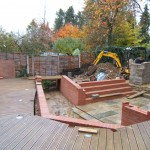 Brick retainers and steps built to lower terrace using reclaimed York stone from stream edging.