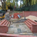 Construction of lower terrace and retaining wall for seating area.
