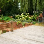 Reclaimed oak decking turns a beautiful silver grey accentuating the reclaimed brickwork.